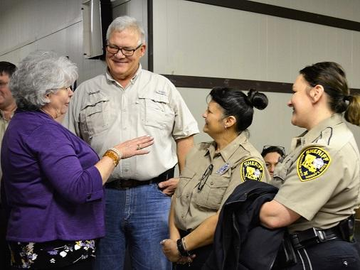 Sheriff and D.A.R.E. Deputies talking with volunteer COA Mardi Gras NEWSLETTER READY.jpg