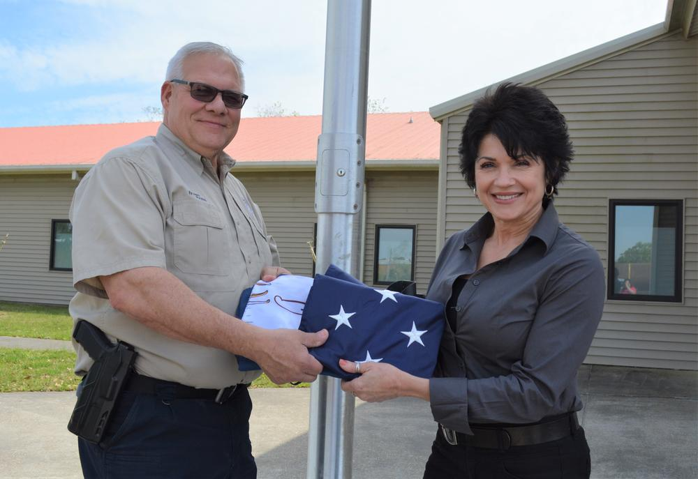 Ins. Co. donates flags to JDPSO.JPG