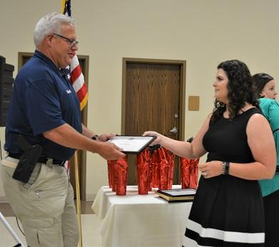 Sheriff Woods accepts the Outstanding Volunteer Award from LSU AgCenter Extension Agent Francis Guidry NEWSLETTER READY.jpg