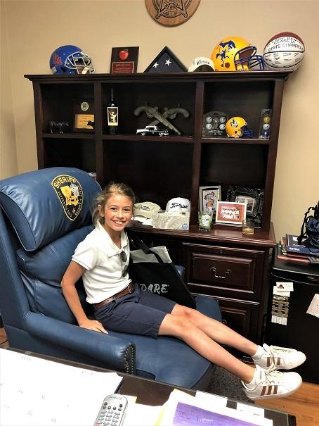 18 Borne in Sheriffs chair NEWSLETTER READY.jpg
