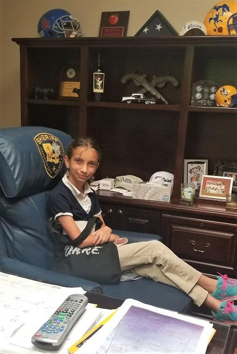 19 Reed in Sheriffs chair NEWSLETTER READY.jpg