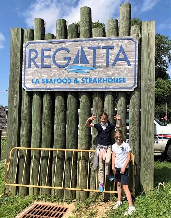 22 Reed and Borne at Regatta sign NEWSLETTER READY.jpg