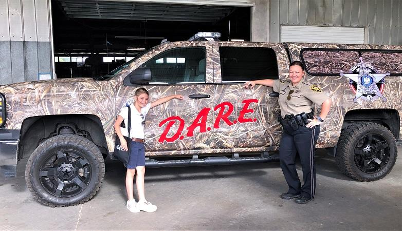 2 D.A.R.E. truck Borne and Miguez NEWSLETTER READY.jpg