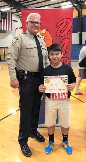 Sheriff with HHS school essay winner Andrew Nguyen BLOG.jpg